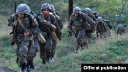 Nagorno-Karabakh -- Soldiers leave a Karabakh Armenian military base at the start of exercises, September 24, 2019.