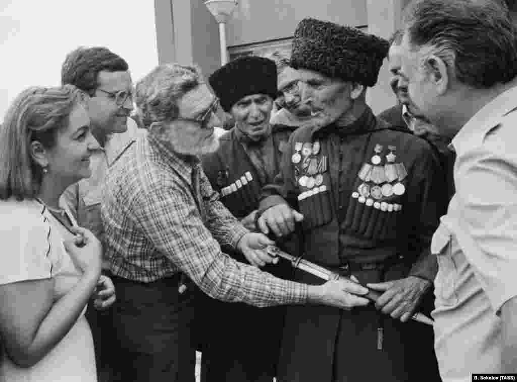 Elderly Abkhaz men with a visiting professor in the 1980s. Under Soviet rule, Abkhazia was initially a full-fledged republic, but in 1931 it was incorporated into Soviet Georgia by Josef Stalin. When this photo was taken, ethnic Abkhaz made up less than 18 percent of Abkhazia's population.