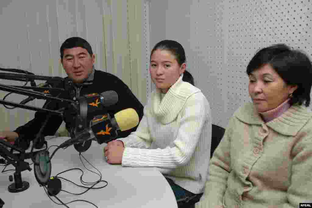 Jangyl Tashbayeva, who was also born in December 1991, with her parents. The family lives in Osh, in southern Kyrgyzstan. Her father was a tradesman in Soviet times, but now owns a store in Bishkek. Her mother gave up her Soviet-era career as a nurse to work as a shop assistant.