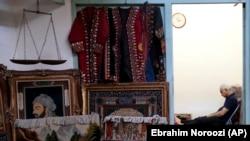 IRAN -- A carpet seller sits at his shop in the old main bazaar in Tehran, Iran, Sunday, June 23, 2019.
