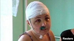 Rape victim Iryna Krashkova speaks to reporters in a hospital ward in Mykolayiv.