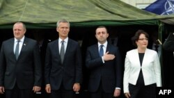 Georgian President Giorgi Margvelashvili (left to right), NATO Secretary-General Jens Stoltenberg, Georgian Prime Minister Irakli Garibashvili, and Georgian Defense Minister Tinatin Khidasheli take part in the inauguration ceremony of the NATO-Georgian Joint Training and Evaluation Center outside Tbilisi on August 27.