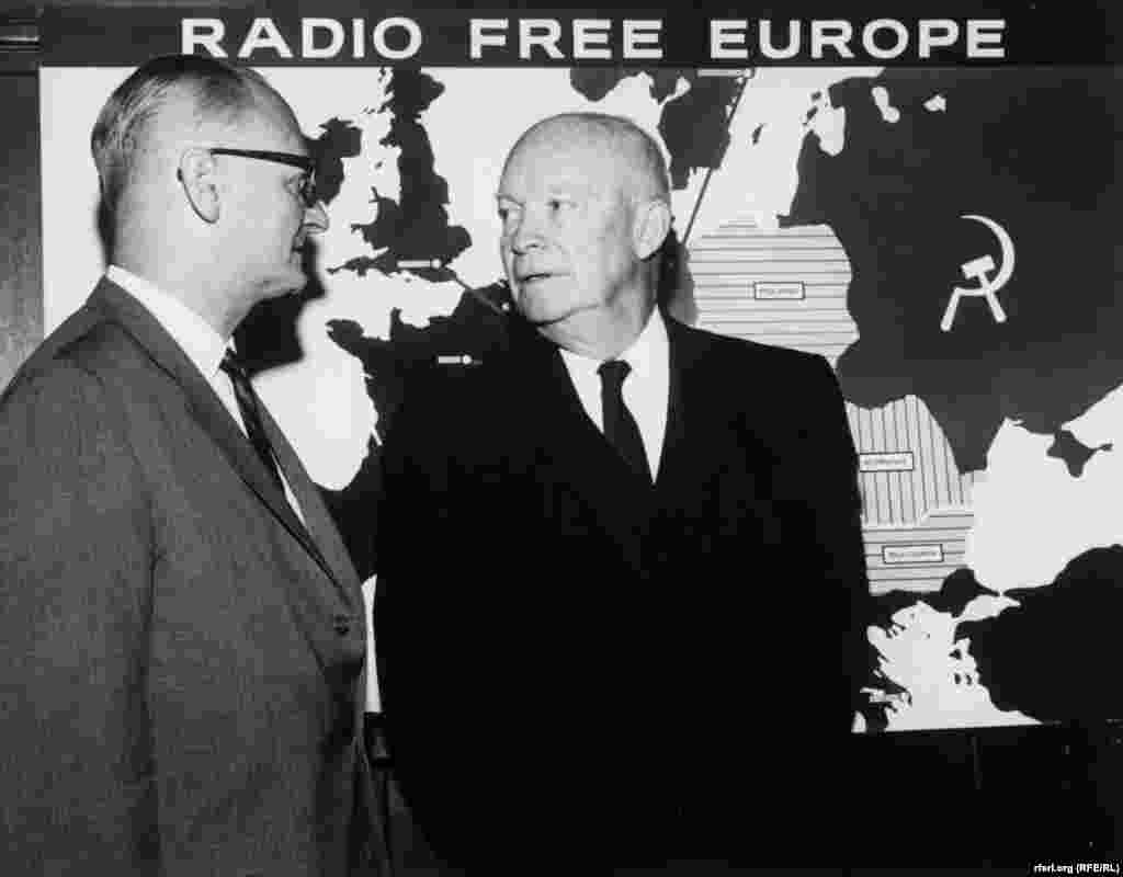 Former U.S. President Dwight D. Eisenhower talks with RFE director C. Rodney Smith in front of a map showing RFE's broadcasting area in the early 1960s.