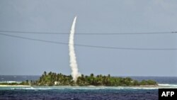 A U.S. interceptor missile is tested over the Marshall Islands in the Pacific.