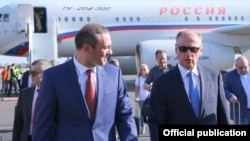 Armenia -- Russian Security Council Secretary Nikolay Patrushev (R) is greeted by his Armenian counterpart Armen Grigorian at Yerevan airport, August 12, 2019.