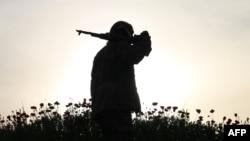 Боец оппозиционной сирийской группировки в городе Дераа