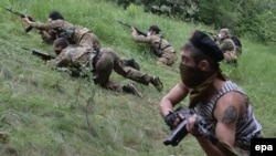 """Pro-Russian gunmen from the """"Vostok Battalion"""" participate in a military exercise near Donetsk on June 1."""