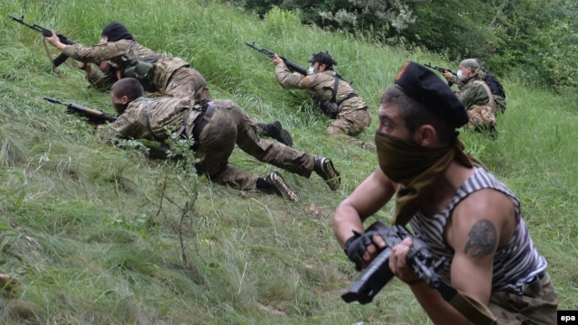 "Pro-Russian gunmen from the ""Vostok Battalion"" participate in a military exercise near Donetsk on June 1."
