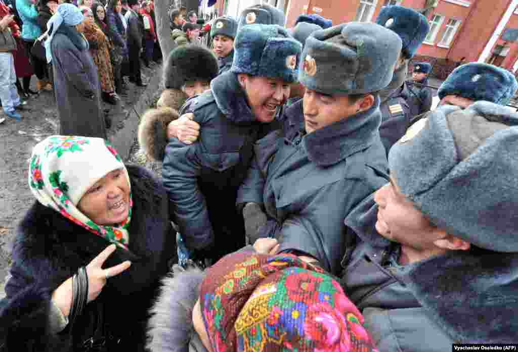 Supporters of detained opposition lawmakers demonstrate in front of a court in the Kyrgyz capital, Bishkek, as the lawmakers stood trial on January 25 for their role in organizing a protest.