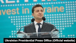 Ukrainian President Volodymyr Zelenskiy delivers the opening speech at the investment forum in Mariupol.