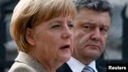 Канцлер Німеччини Ангела Меркель і президент України Петро Порошенко