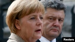 Germany's Chancellor Angela Merkel speaks during a news conference with Ukraine's President Petro Poroshenko in Kyiv.