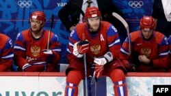Aleksandr Ovechkin looks on from the bench during the Russian ice hockey team's quarterfinal loss to Canada.