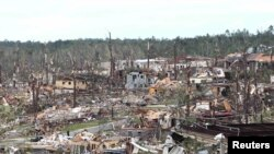 Tornadoes have torn through Alabama and other U.S. southern states, killing more than 300 people. This photo shows the devastation in Pratt City, a suburb of Birmingham, Alabama.