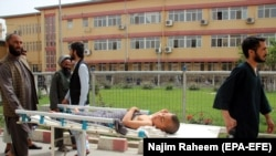 FILE: An Afghan boy who was injured in an airstrike on a religious seminary receives medical treatment at a hospital in the northeastern Afghan city Kunduz in April.