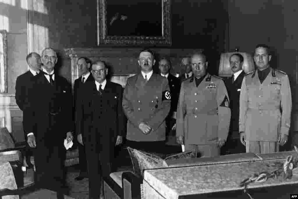 Prime Ministers (left to right) Lord Neville Chamberlain of the United Kingdom and Edouard Daladier of France, German Chancellor Adolf Hitler, Italian Prime Minister Benito Mussolini and Foreign Minister Count Gian Galeazzo Ciano gather in Munich on September 29, 1938, to sign the Munich treaty between Nazi Germany, France, Italy, and the United Kingdom, authorizing Hitler to annex the Czech territory called the Sudetenland.
