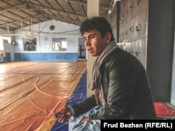 """Peace with the Taliban will not be a peace at all,"" says Ahmad Zia at the wrestling club."