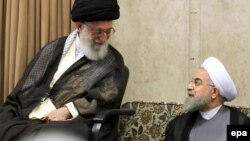Iranian Supreme Leader Ayatollah Ali Khamenei (left) appears to have revived an intelligence unit around the same time Hassan Rohani (right) became president in the summer of 2013.