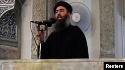 """""""Ислам мемлекеті"""" экстремистік тобының басшысы Әбу Бакр әл-Бағдади деп сипатталатын адамның фотосы."""