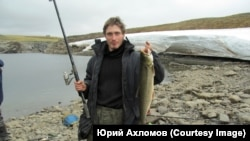 Юрий Ахломов
