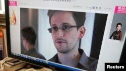АҚШ Ұлттық қауіпсіздік агенттігінің қызметкері Эдвард Сноуденнің суреті. Пекин, 13 маусым 2013 жыл.