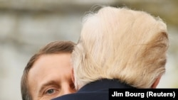 U.S. -- U.S. President Donald Trump and French President Emmanuel Macron hug during an arrival ceremony at the White House in Washington, U.S., April 24, 2018
