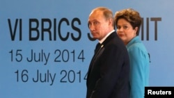 Brazilian President Dilma Rousseff (right) walks with Russian President Vladimir Putin before the sixth BRICS summit in Fortaleza, Brazil, on July 15.