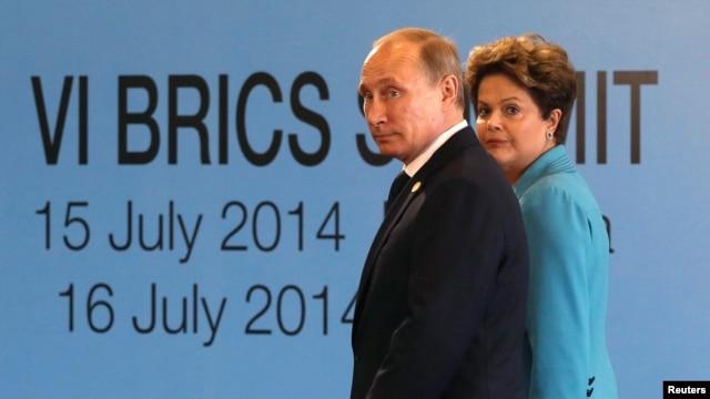 Brazilian President Dilma Rousseff (right) walks with Russian President Vladimir Putin before the sixth BRICS summit in Fortaleza, Brazil, on July 15.