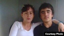 Мижгона Худойдодова вместе с сыном