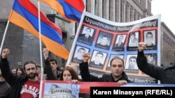 Armenia -- Opposition demonstrators hold up pictures of 10 men killed in the 2008 post-election violence in Yerevan, 1Mar2013.