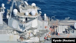 USS Fitzgerald destroyer, damaged by colliding with a Philippine-flagged merchant vessel, is seen off Shimoda