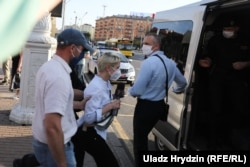 RFE/RL correspondent Alyaksandra Dynko is detained whlle covering a rally in Minsk on June 19.