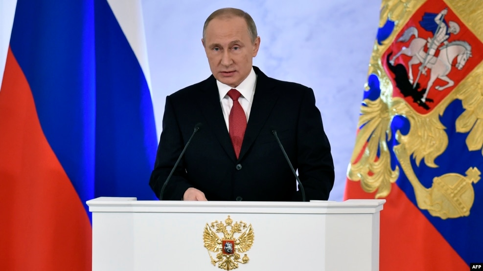 Russian President Vladimir Putin gives his annual address to a joint session of parliament and the government at the Kremlin on December 1.