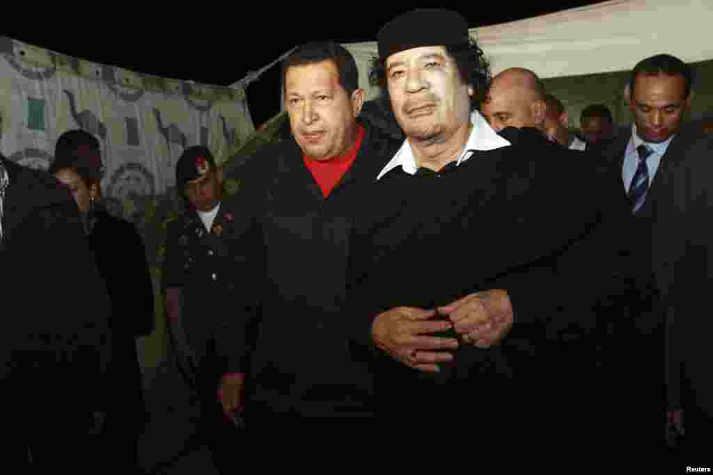 Chavez is greeted by then-Libyan leader Muammar Qaddafi (right) upon his arrival in Tripoli in October 2010.