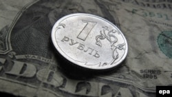 The ruble remained in free fall through December 16, nearing the psychological barrier of 80 to the dollar.