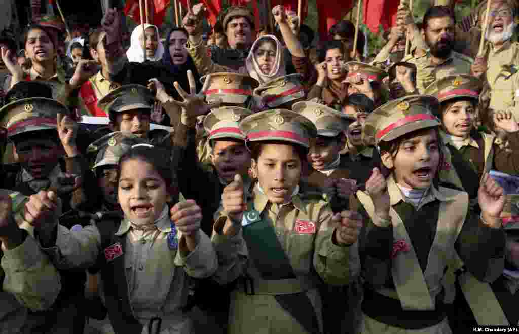 Children wearing army uniforms protest against the recent U.S. attack in Iraq that killed Iranian military commander Qasem Soleimani, near the U.S. consulate in Lahore, Pakistan. (AP/K.M. Chaudary)