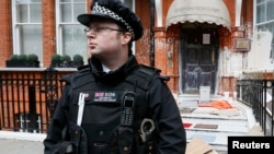 U.K. -- A police officer stands outside the Iranian consulate in central London, 14Jun2013