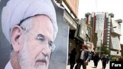 Posters of presidential candidate Mehdi Karrubi in Tehran in late May