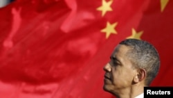 U.S. -- President Barack Obama listens as Chinese President speaks during an official South Lawn arrival ceremony for Hu at the White House in Washington, DC, 19Jan2011