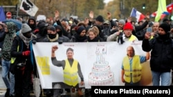 "Protesters attend a demonstration to mark the first anniversary of the ""yellow vests"" movement in Paris, France, November 16, 2019"
