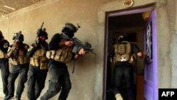 قوات عراقية خاصة خلال عملية تفتيش في جرف الصخر - 30 تشرين الأول 2014
