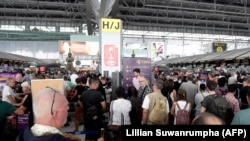 Stranded passengers wait at Bangkok's Suvarnabhumi International Airport on February 28 after Thai Airways canceled 11 European-bound flights.