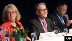Swedish Environment Minister Lena Ek (left to right), and Thomas Stocker and Qin Dahe of the IPCC working group attend a meeting of the Intergovernmental Panel on Climate Change (IPCC) in Stockholm, Sweden, on September 23.