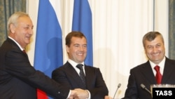 "Russian President Dmitry Medvedev (center), with South Ossetian and Abkhaz leaders Sergei Bagapsh (left) and Eduard Kokoity, has moved quickly to ""normalize"" diplomatic ties with both regions."