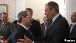 Russian Foreign Minister Sergei Lavrov (right) welcomed Syrian Deputy Foreign Minister Faisal Mekdad for a meeting in Moscow on May 22.