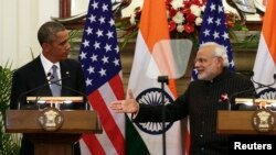 Indian Prime Minister Narendra Modi, right, reaches out to shake hands with U.S. President Barack Obama after giving their opening statements at Hyderabad House in New Delhi, January 2015.