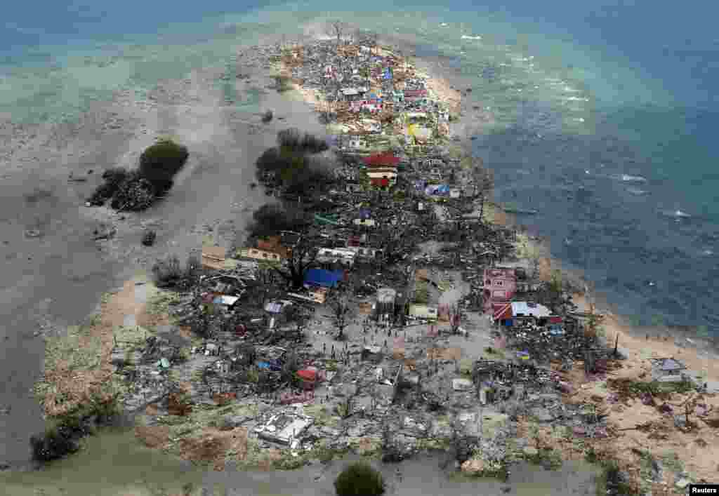 An aerial view shows a coastal town devastated by super Typhoon Haiyan, in Samar province in central Philippines. (Reuters/Erik De Castro)
