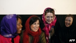 American actresses Annette Bening (right) and Alfre Woodard (left), wearing headscarves, attend a workshop with Iranian actresses Fatemeh Motamed Aria (2nd-left) and Bahareh Rahnama (2nd-right) at the House of Cinema in Tehran