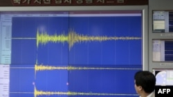 A South Korean scientist shows seismic waves created by the North's nuclear test in May.