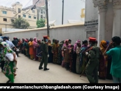 Dhaka locals lining up for food being handed out at the Armenian Church in 2020.